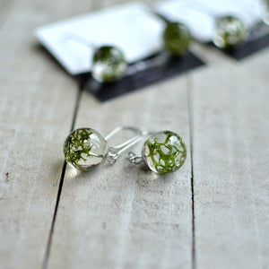 Handcrafted earrings feature a piece of beautiful green Norwegian moss, preserved in the clear jewelry grade resin.