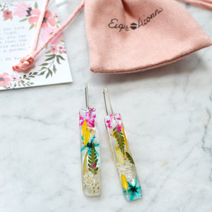 Unique earrings feature miniature bright flowers and leaves carefully arranged into a cheerful bouquet for pop of color. All flora is professionally preserved in high-quality jewelry grade Eco-resin and will last a lifetime for you to admire without loosing its original beauty.