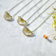 Load image into Gallery viewer, Minimalist yet unique and contemporary design. A pendant featuring locally sourced preserved Queen Anne's lace in the brass half circle.