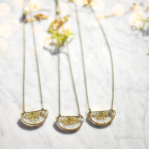Minimalist yet unique and contemporary design. A pendant featuring locally sourced preserved Queen Anne's lace in the brass half circle.