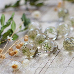 Real preserved Queens' Anne's Lace flowers are encased in the clear jewelry grade resin.
