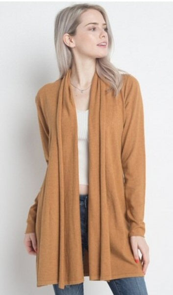 Dreamers cardigan sweater is so soft and fashionable. Shop Bennetts Clothing where you can always find the latest and greatest in womens fashions.