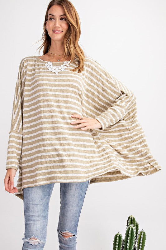 Easel Oversized Tunic Tee is so chic and perfect for warm weather. Shop Bennetts Clothing for the latest in name brand fashions
