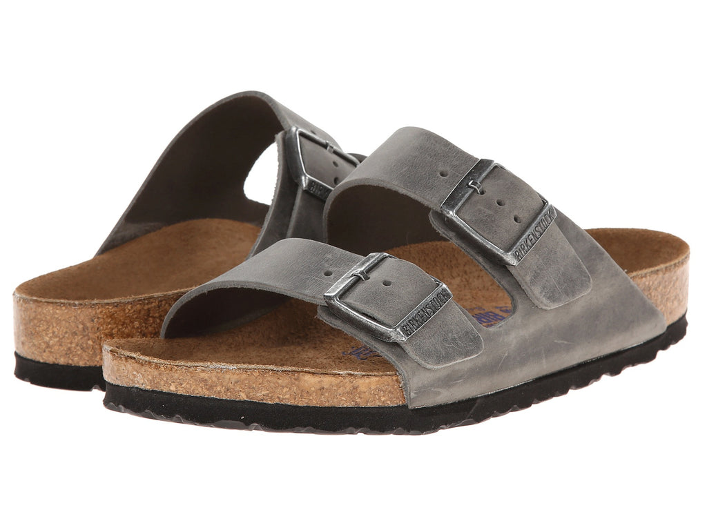 Birkenstock Arizona Soft Footbed Sandal in cool a Iron Oil finish matches all your outfits. Shop Bennett's Clothing for a large selection of Birkenstock to fit the whole family.