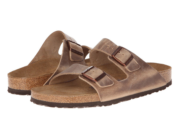 Birkenstock Arizona Soft Footbed Sandal in Tobacco Oiled finish matches all your outfits. Shop Bennett's Clothing for a large selection of Birkenstock to fit the whole family.