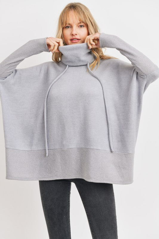 Cherish soft and comfy brushed fleece pullover has a drawstring and chic style. Shop Bennett's for the latest styles in womens clothing shipped same day to your front door.