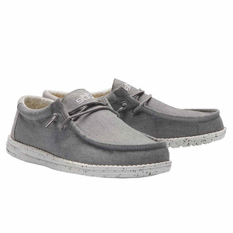 Hey Dude Wally Chambray slip-on shoes takes comfort to a whole new level.  Shop Bennett's Clothing for the brands you want and the customer service you deserve.