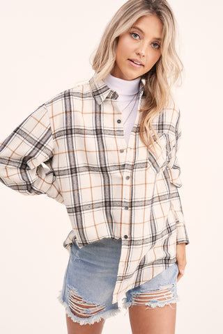 La Miel Classic Plaid Top will make a comfortable and fashionable shirt this season. Shop Bennett's for a large selection of women's clothing shipped same day to your front door.