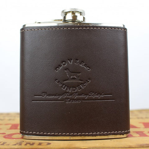 Over Under Logo Leather Flask has unmatched style to hold your favorite toddy. Shop Bennetts Clothing for the the brands that separate the gentlemen from the boys.