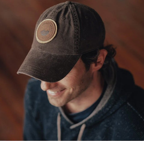 The Normal Brand Duck Leather Cap is rugged and ready for your next adventure. Shop Bennett's Clothing for the best name brands with same day shipping to your front door.
