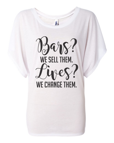 Bars? We sell them. Lives? We change them. - Bella Canvas Women's Flowy Draped Sleeve Dolman Tee