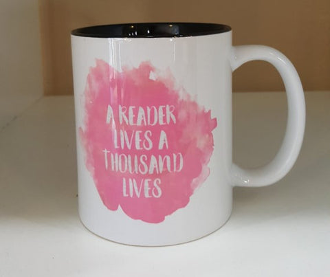 A reader lives a thousand lives coffee mug.