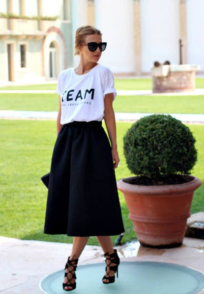 tucked graphic tee paired with a fun, full skirt
