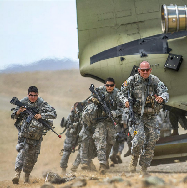Army Combat Engineers run from a CH47 Chinook helicopter after being notified of a sale on old school Nike SFB's.