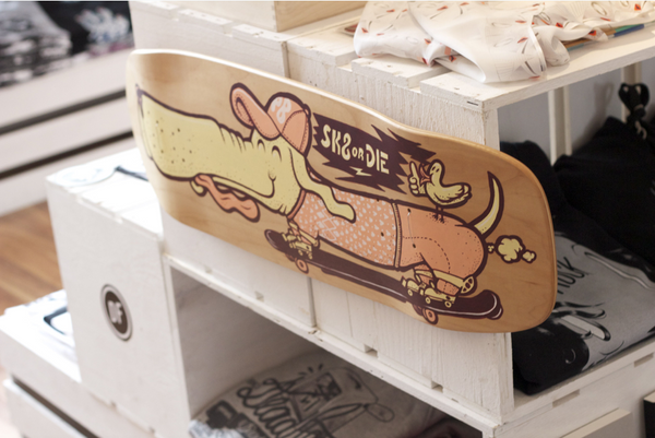 Unique skateboard with street art design at Wild Wood street art store and gallery in Kassel, Germany