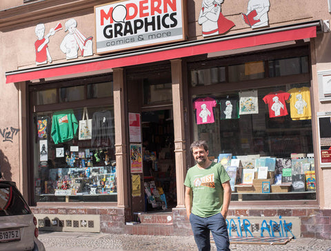 Micha Wiesler in front of his comic and bookshop Modern Graphics in Berlin, Kreuzberg