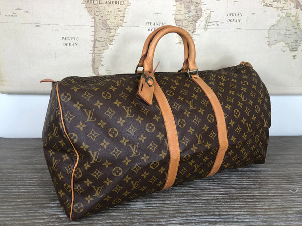 LOUIS VUITTON Monogram Keepall 55 Duffel Bag