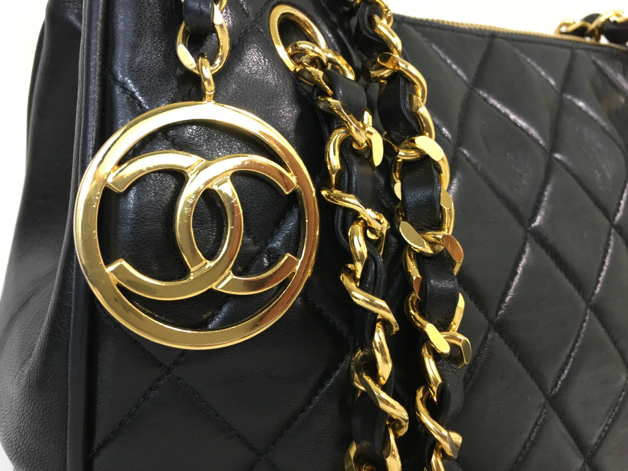 CHANEL Black Lambskin Quilted CC Charm Shoulder Bag