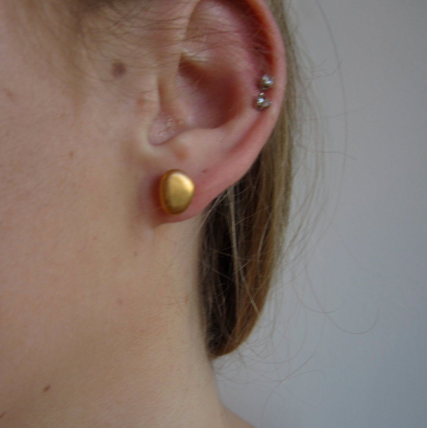 dipped gold dogeared balance stud earrings tiny bar flat