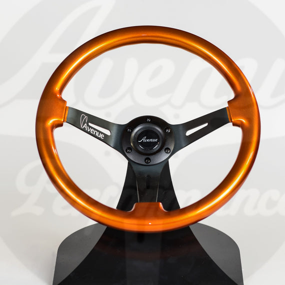 AVENUE BURNT ORANGE/ BLACK SPOKES STEERING WHEEL