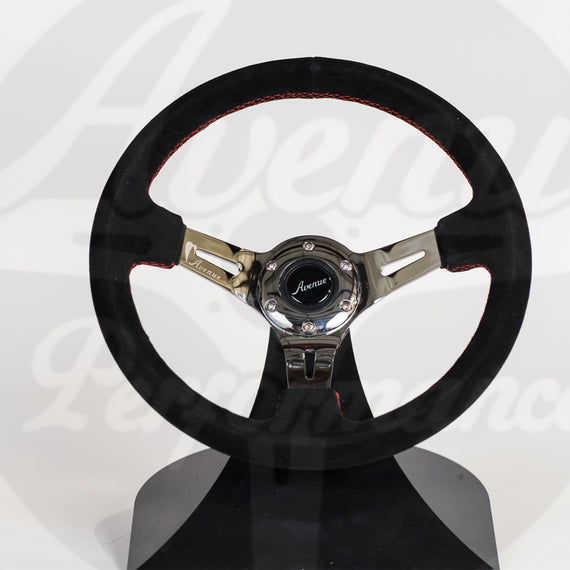 AVENUE STEERING WHEEL BLK SUEDE/ RED STITCHING/ CHROME SPOKES