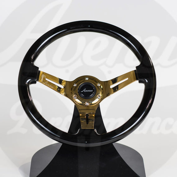 AVENUE STEERING WHEEL RAVEN BLACK W/ GOLD SPOKES