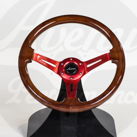 AVENUE STEERING WHEEL WOODGRAIN W/ RED SPOKES (LIMITED SERIES)