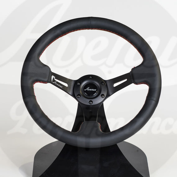 AVENUE BLACK LEATHER/ RED STITCH/ BLACK SPOKES STEERING WHEEL