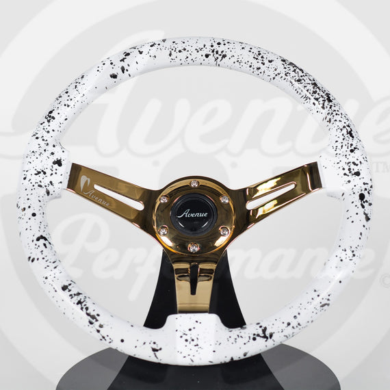 AVENUE WHITE BASE/ BLACK SPLATTER/ GOLD SPOKES STEERING WHEEL (LIMITED EDITION)