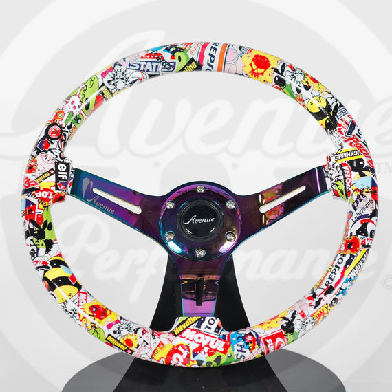 AVENUE STICKERBOMB/ NEOCHROME SPOKES HYDRO DIPPED STEERING WHEEL
