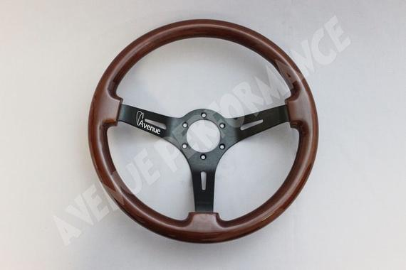 AVENUE WOODGRAIN W/ BLACK SPOKE AS-IS STEERING WHEEL