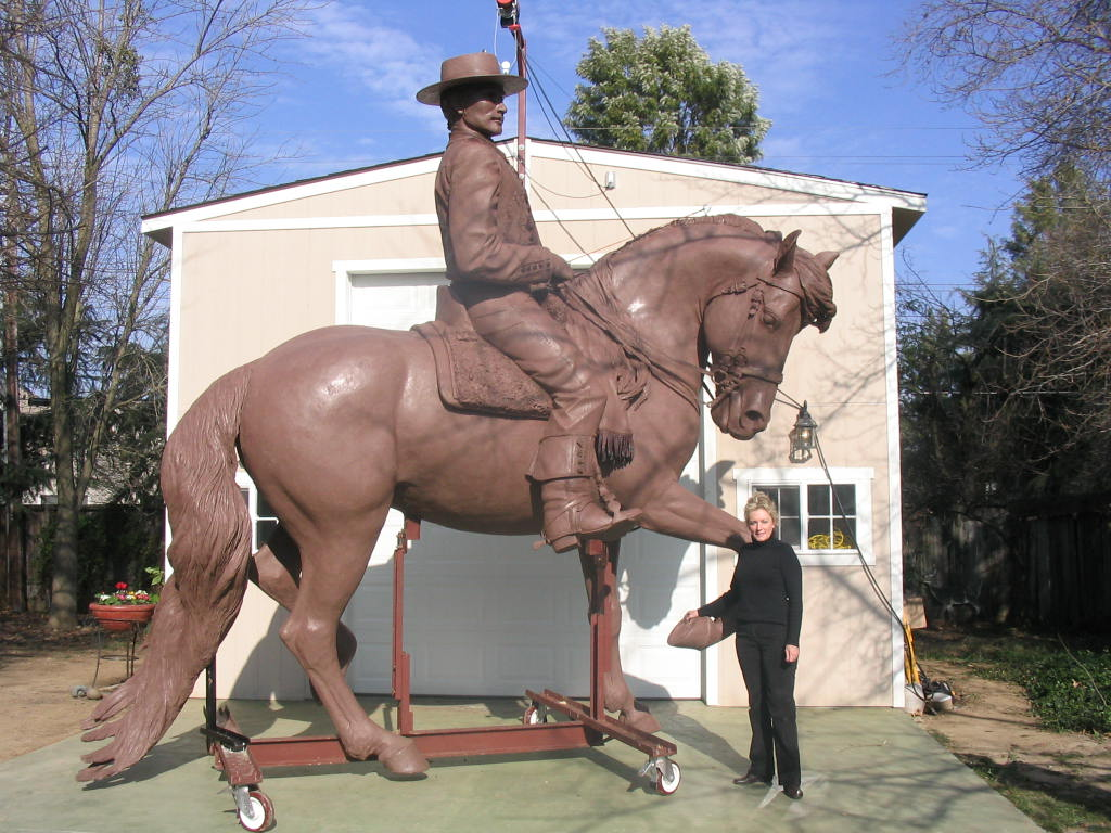 Patricia Borum with monumental clay model for Spanish horse and rider sculpture