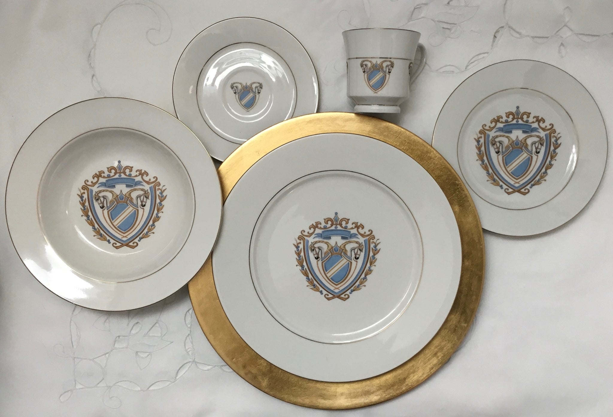 Horse coat of arms dinner plates in blue by Patricia Borum