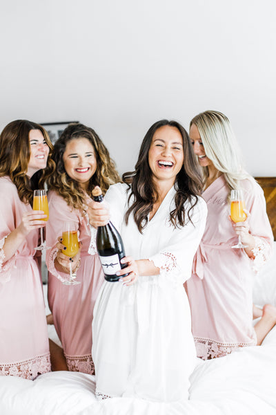 Lace Bridesmaid and Bridal Robes perfect for bachelorette party with champagne