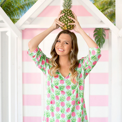 Lady holding pineapple in Sweet Paradise Swim Cover Up