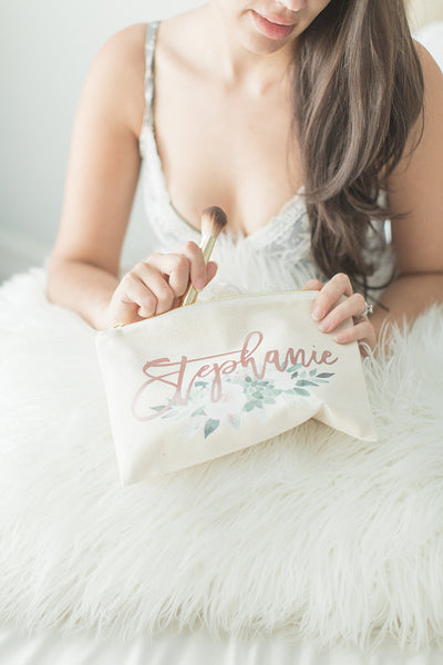 Lady holding Floral Bridesmaid Makeup Bag with gold zipper