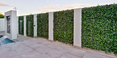 artificial ivy panel on a pool fence