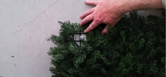 Installing fake hedges onto concrete walls