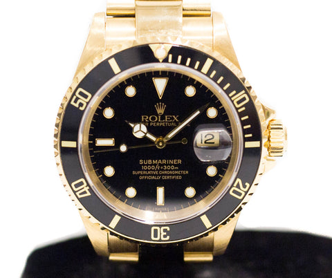 Preowned Rolex Submariner in Yellow Gold 16618