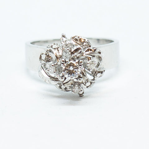 0.15 Carat Floral Round Cut Diamond on White Gold Casing (347)