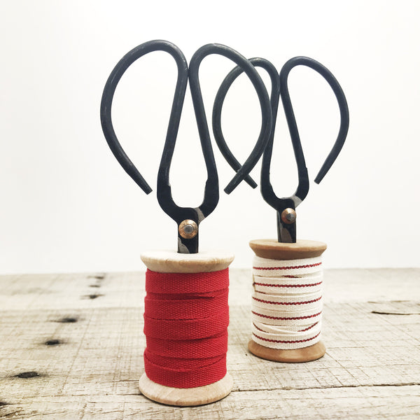 Red Cotton Ribbon on Spool with Scissors