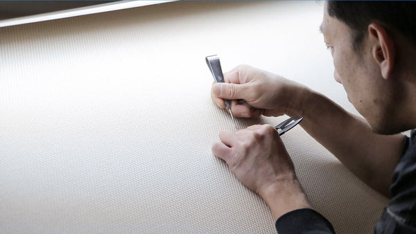 The Sashiko fabric may have loose stitches after the production. The fabric is then checked entirely by hand.