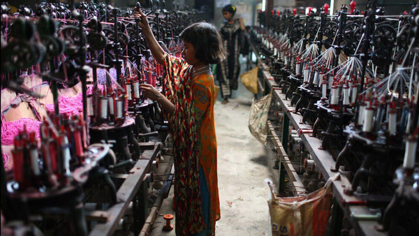 Child labor in a textile factory in Dhaka, Bangladesh