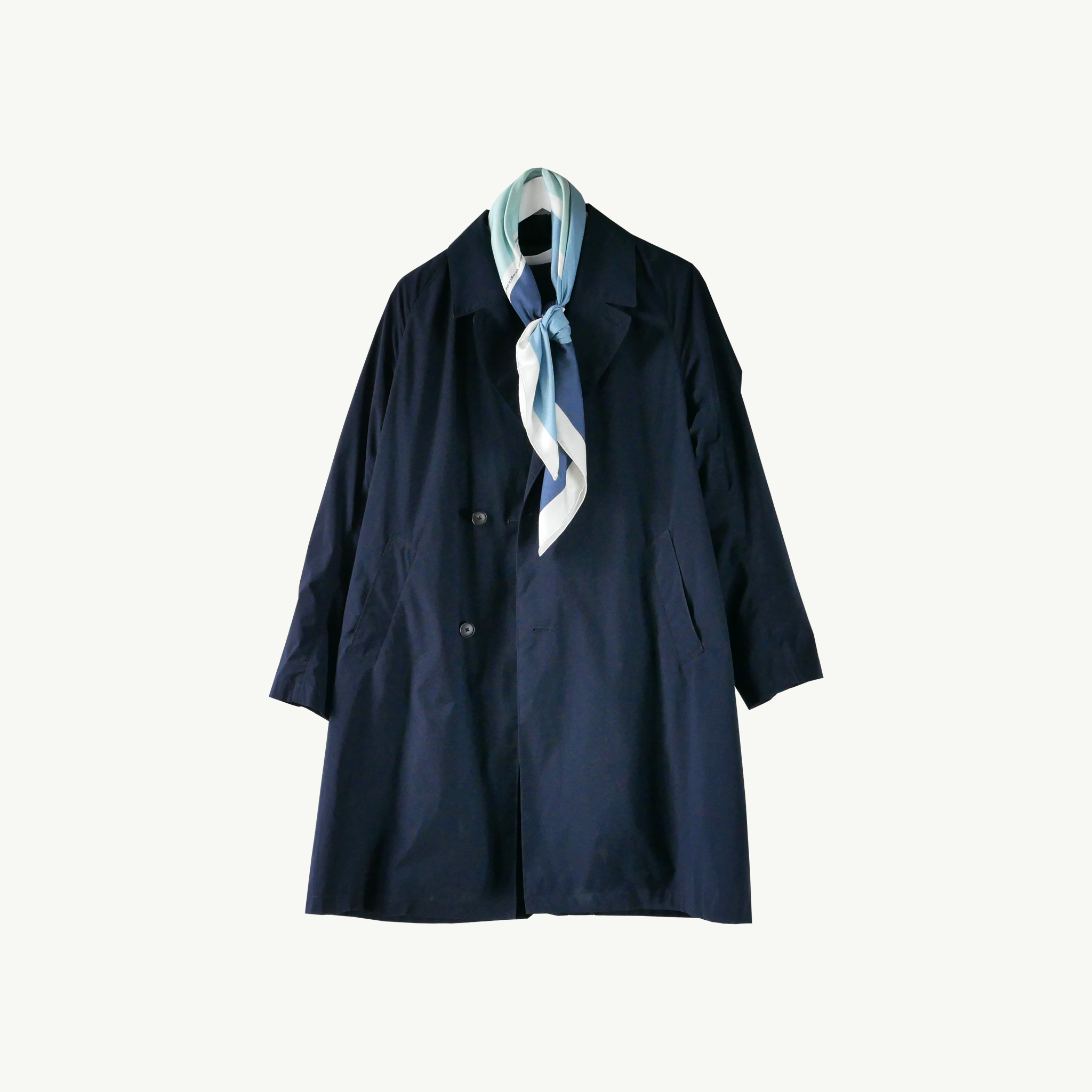 Les Belles Heures Arcipelago, 12h13 100% hand rolled cashmere, modal and silk scarf in our 90cm format worn on a navy oversized raincoat