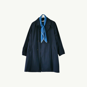 Les Belles Heures Cavallo, 18h17 100% hand rolled cashmere, modal and silk scarf in our 90cm format worn on a navy oversized raincoat