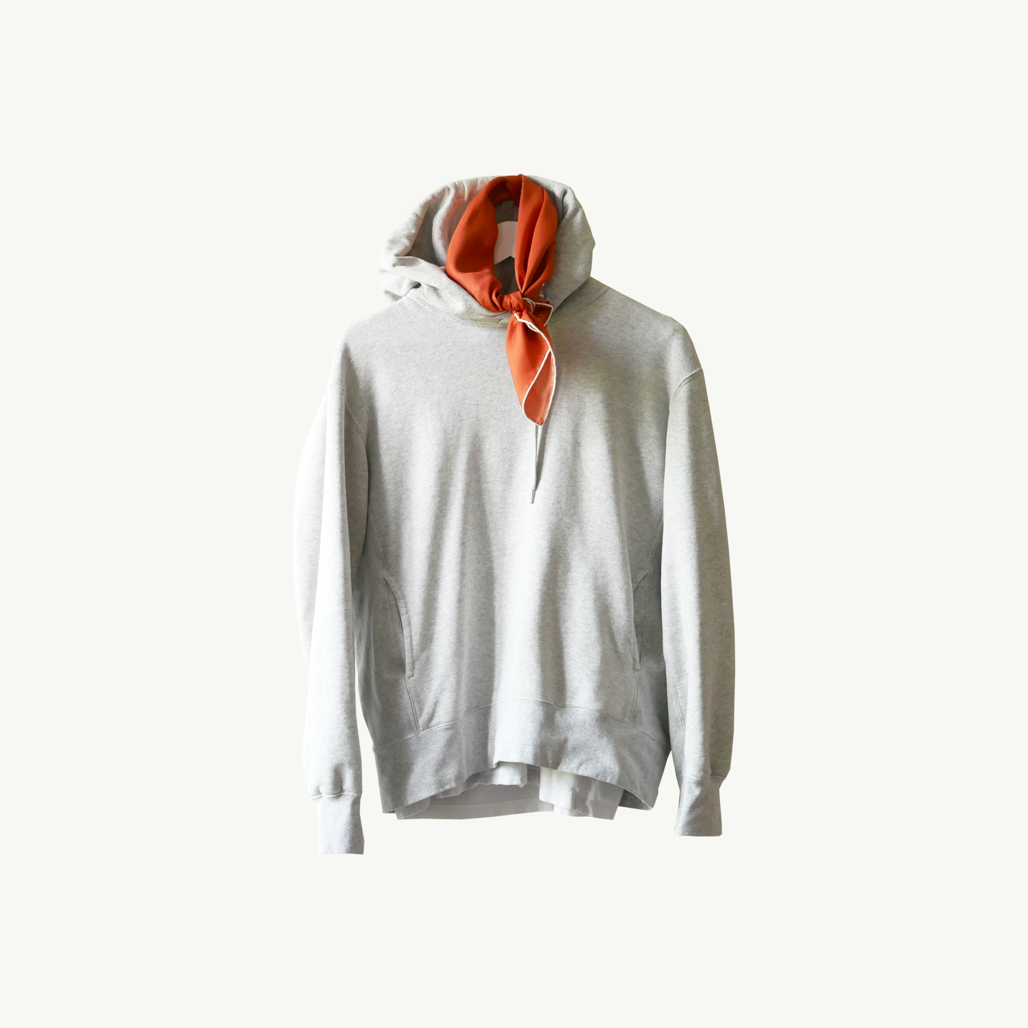 Les Belles Heures Senigallia, 15h32 100% hand rolled cashmere, modal and silk scarf worn with a grey hoodie over a white tee