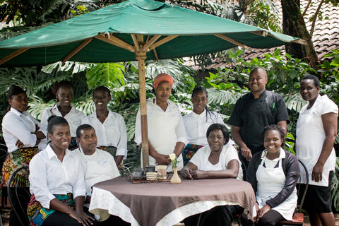 photo of amani cafe staff around a table in kenya