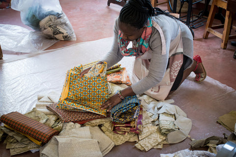 amani-aseamstress-sorting-through-material-to-make-quilt