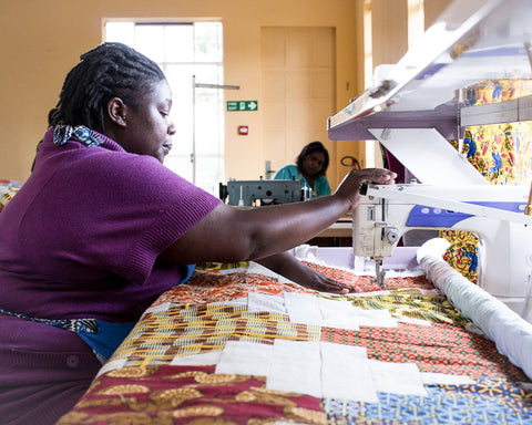 seamstress-sewing-quilt-together-on-free-hand-quilting-machine