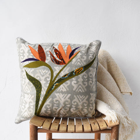 Kenyan cotton pillow featuring bird of paradise flower